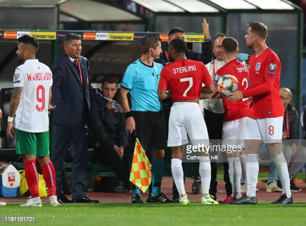 Raheem Sterling, Kieran Trippier and Jordan Henderson speak with Krasimir Balakov manager of Bulgaria during the UEFA Euro 2020 qualifier between...