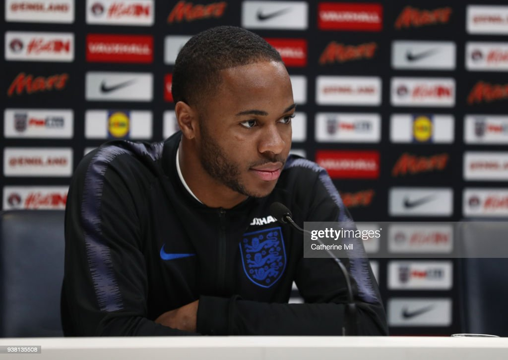 Raheem Sterling looks on during an England press conference on the eve of their international friendly against Italy at Tottenham Hotspur Training Centre, on March 26, 2018 in Enfield, England.