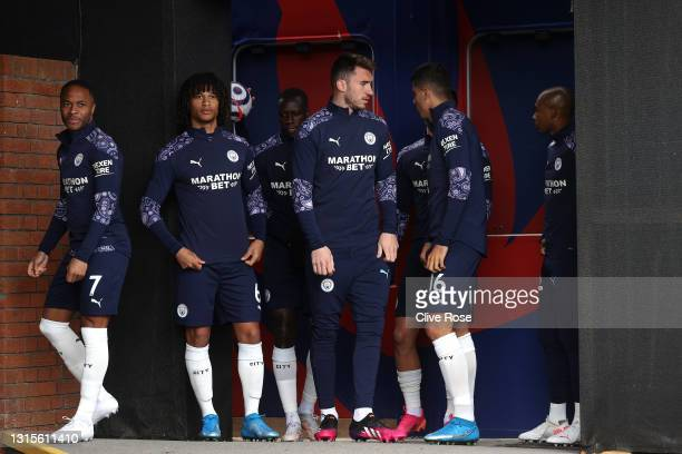 Raheem Sterling, Nathan Ake, Aymeric Laporte and Rodrigo of Manchester City speak in the tunnel before walking out for the warm up prior to the...
