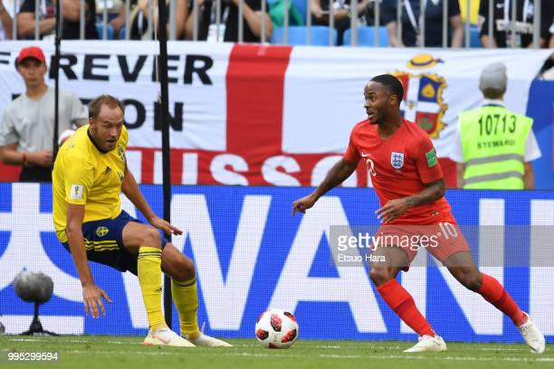 Raheem Sterling of England and Andreas Granqvist of Sweden compete for the ball during the 2018 FIFA World Cup Russia Quarter Final match between...