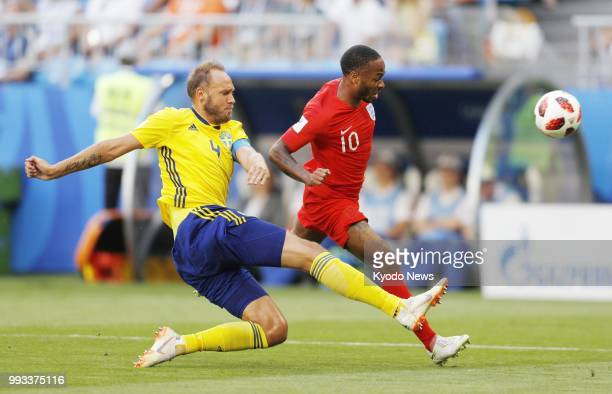 Raheem Sterling of England and Andreas Granqvist of Sweden vie for the ball during the first half of a World Cup quarterfinal between the two...