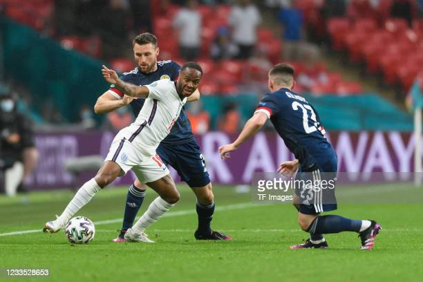 Raheem Sterling of England and Billy Gilmour battle for the ball during the UEFA Euro 2020 Championship Group D match between England and Scotland at...