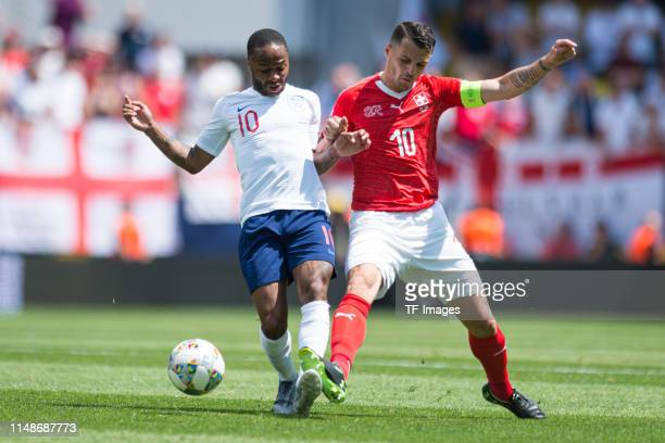 Raheem Sterling of England and Granit Xhaka of Switzerland battle for the ball during the UEFA Nations League Third Place Playoff match between...