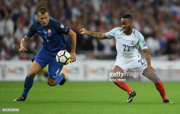 Raheem Sterling of England and Jan Durica of Slovakia battle for the ball during the FIFA 2018 World Cup Qualifier between England and Slovakia at...