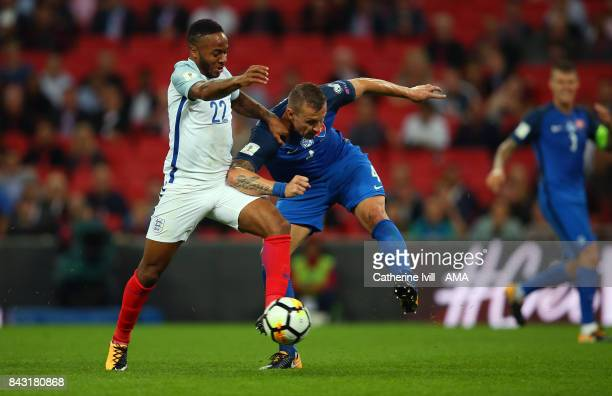 Raheem Sterling of England and Jan Durica of Slovakia during the FIFA 2018 World Cup Qualifier between England and Slovakia at Wembley Stadium on...