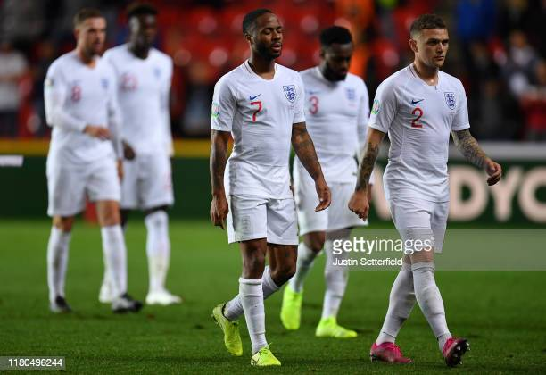 Raheem Sterling of England and Kieran Trippier of England look dejected after the UEFA Euro 2020 qualifier between Czech Republic and England at...