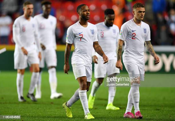 Raheem Sterling of England and Kieran Trippier of England react after the UEFA Euro 2020 qualifier between Czech Republic and England at Sinobo...