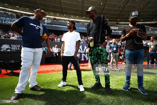Raheem Sterling of England and Manchester City speaks with CC Sabathia of the New York Yankees on the field during previews ahead of the MLB London...