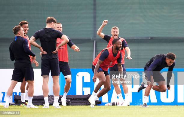 Raheem Sterling of England and Trent AlexanderArnold of England enjoy a drill during a training session during the England Media Access at on June 17...