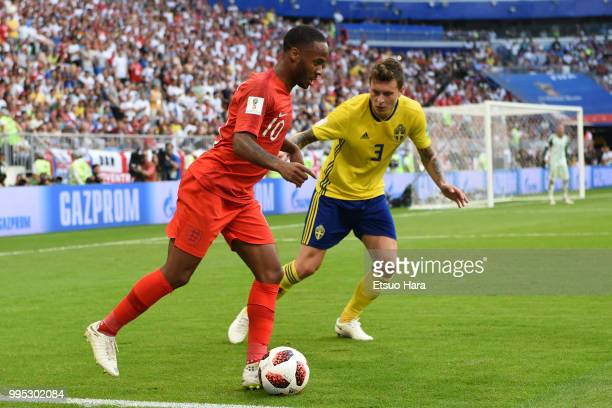 Raheem Sterling of England and Victor Lindelof of Sweden compete for the ball during the 2018 FIFA World Cup Russia Quarter Final match between...
