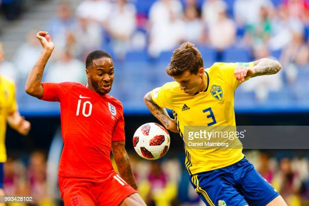 Raheem Sterling of England and Victor Lindelof of Sweden focused on the ball during the 2018 FIFA World Cup Russia Quarter Final match between Sweden...
