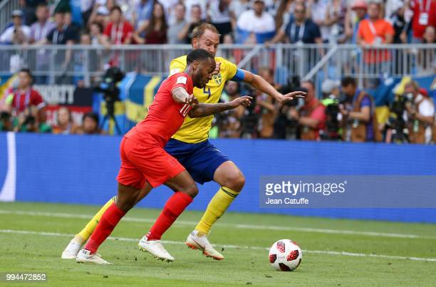 Raheem Sterling of England Andreas Granqvist of Sweden during the 2018 FIFA World Cup Russia Quarter Final match between Sweden and England at Samara...