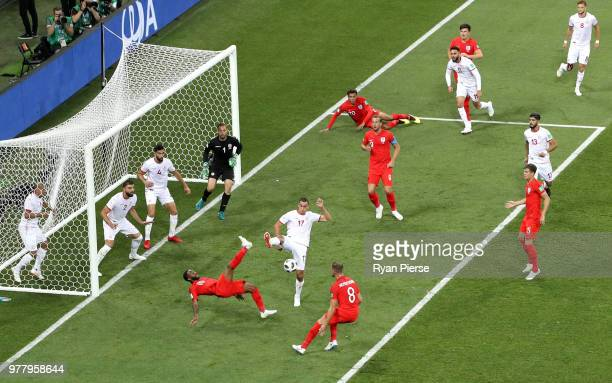 Raheem Sterling of England attempts an overhead kick but is denied by Ellyes Skhiri of Tunisia during the 2018 FIFA World Cup Russia group G match...