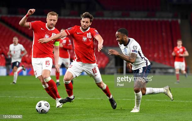 Raheem Sterling of England attempts to run past Bartosz Bereszynski of Poland during the FIFA World Cup 2022 Qatar qualifying match between England...