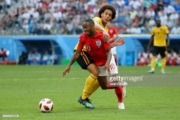 Raheem Sterling of England Axel Witsel of Belgium during the 2018 FIFA World Cup Russia 3rd Place Playoff match between Belgium and England at Saint...
