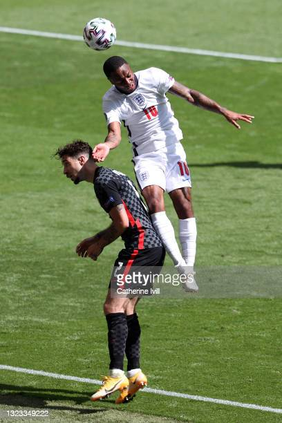 Raheem Sterling of England battles for a header with Sime Vrsaljko of Croatia during the UEFA Euro 2020 Championship Group D match between England...