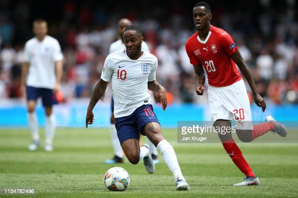 Raheem Sterling of England battles for possession with Edimilson Fernandes of Switzerland during the UEFA Nations League Third Place Playoff match...