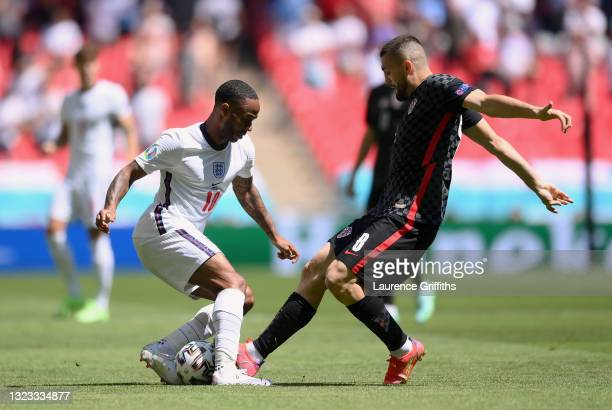 Raheem Sterling of England battles for possession with Mateo Kovacic of Croatia during the UEFA Euro 2020 Championship Group D match between England...