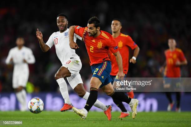 Raheem Sterling of England battles for the ball with Jonny of Spain during the UEFA Nations League A group four match between Spain and England at...