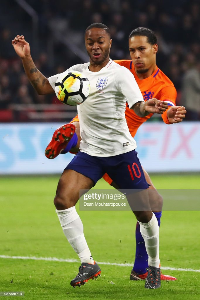 Raheem Sterling of England battles for the ball with Virgil van Dijk of the Netherlands during the International Friendly match between Netherlands and England at Amsterdam ArenA also called the Johan Cruyff Arena on March 23, 2018 in Amsterdam, Netherlands.
