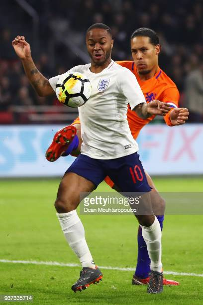 Raheem Sterling of England battles for the ball with Virgil van Dijk of the Netherlands during the International Friendly match between Netherlands...
