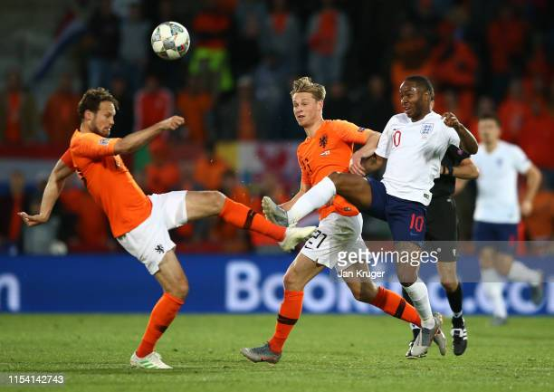 Raheem Sterling of England battles with Daley Blind of the Netherlands during the UEFA Nations League SemiFinal match between the Netherlands and...