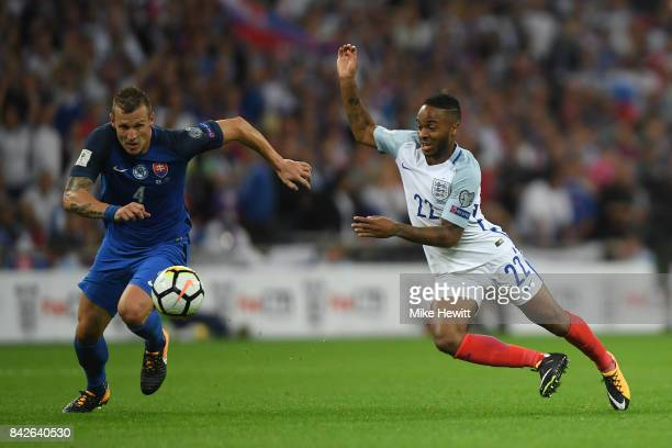 Raheem Sterling of England battles with Jan Durica of Slovakia during the FIFA 2018 World Cup Qualifier between England and Slovakia at Wembley...