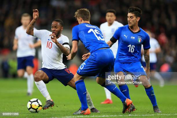 Raheem Sterling of England battles with Lorenzo Pellegrini of Italy during the international friendly match between England and Italy at Wembley...