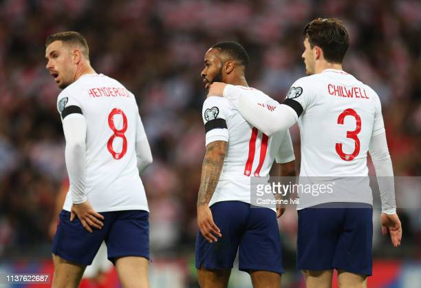 Raheem Sterling of England celebrates after scoring his team's first goal with team mates Jordan Henderson and Ben Chilwell during the 2020 UEFA...