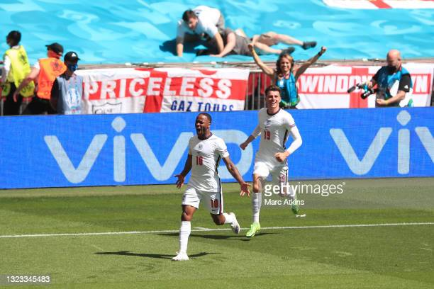 Raheem Sterling of England celebrates after scoring his team's first goal during the UEFA Euro 2020 Championship Group D match between England and...