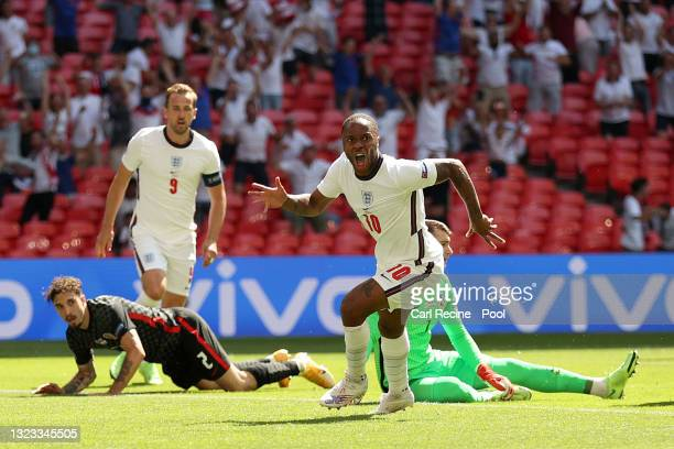 Raheem Sterling of England celebrates after scoring their side's first goal during the UEFA Euro 2020 Championship Group D match between England and...