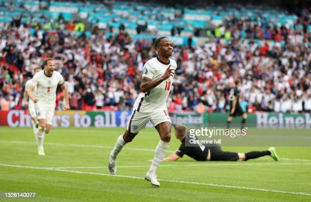 Raheem Sterling of England celebrates after scoring their side's first goal during the UEFA Euro 2020 Championship Round of 16 match between England...