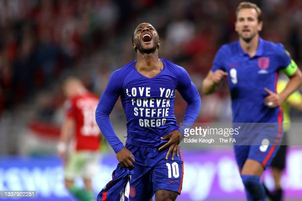 """Raheem Sterling of England celebrates after scoring their team's first goal wearing a t-shirt that reads """"Love You Forever Steffie Gregg"""" during the..."""