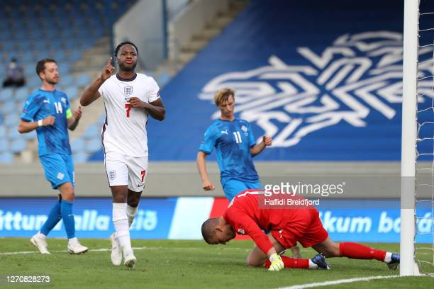 Raheem Sterling of England celebrates scoring his sides first goal from the penalty spot during the UEFA Nations League group stage match between...