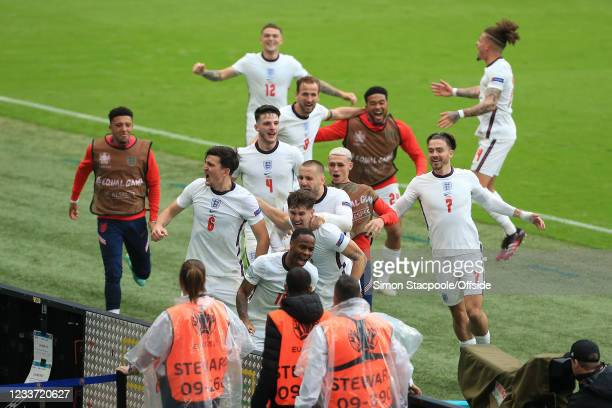 Raheem Sterling of England celebrates scoring the opening goal with his team during the UEFA Euro 2020 Championship Round of 16 match between England...