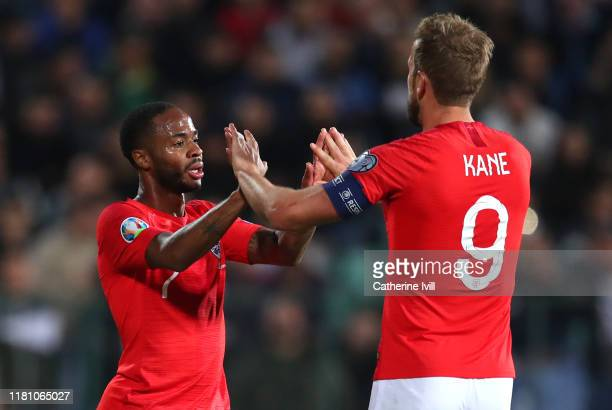 Raheem Sterling of England celebrates with Harry Kane after he scores his sides fifth goal during the UEFA Euro 2020 qualifier between Bulgaria and...