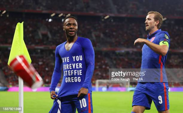 """Raheem Sterling of England celebrates with Harry Kane after scoring their team's first goal wearing a t-shirt that reads """"Love You Forever Steffie..."""