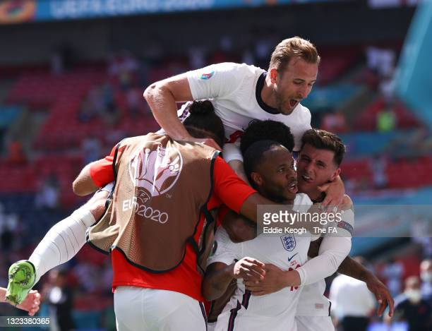 Raheem Sterling of England celebrates with Harry Kane and Mason Mount after scoring their side's first goal during the UEFA Euro 2020 Championship...