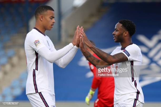 Raheem Sterling of England celebrates with Mason Greenwood of England after scoring his sides first goal from the penalty spot during the UEFA...