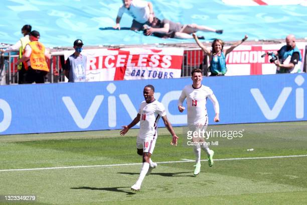 Raheem Sterling of England celebrates with Mason Mount after scoring their side's first goal as fans celebrate during the UEFA Euro 2020 Championship...