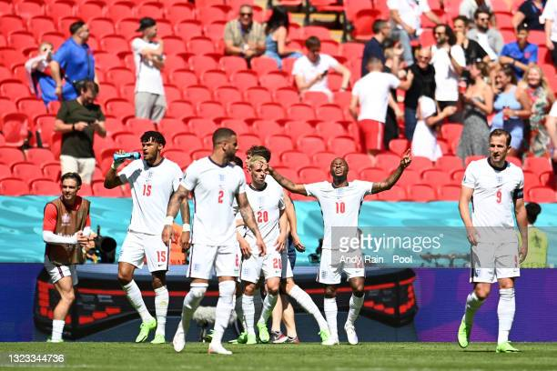 Raheem Sterling of England celebrates with team mates after scoring their side's first goal during the UEFA Euro 2020 Championship Group D match...