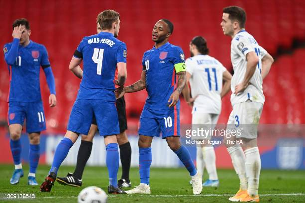 Raheem Sterling of England celebrates with teammate James Ward-Prowse after scoring their team's third goal during the FIFA World Cup 2022 Qatar...