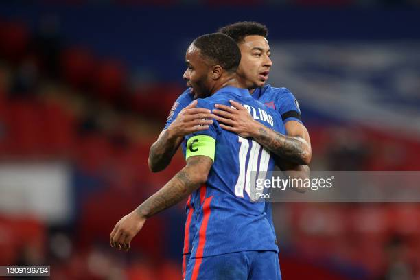 Raheem Sterling of England celebrates with teammate Jesse Lingard after scoring their team's third goal during the FIFA World Cup 2022 Qatar...