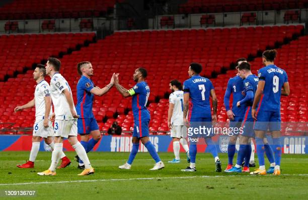 Raheem Sterling of England celebrates with teammate Kalvin Phillips after scoring their team's third goal during the FIFA World Cup 2022 Qatar...