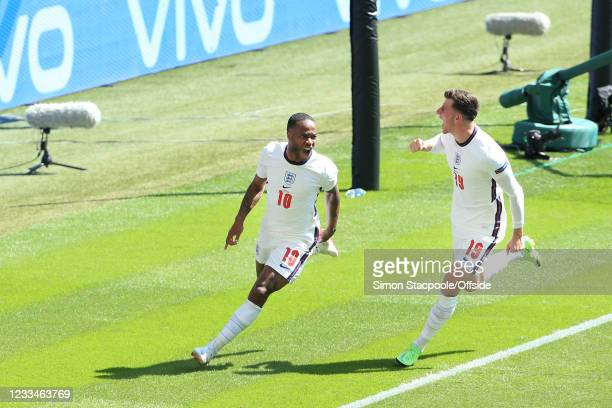 Raheem Sterling of England celebrates with teammate Mason Mount of England after scoring their 1st goal during the UEFA Euro 2020 Championship Group...