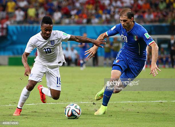 Raheem Sterling of England controls the ball against Gabriel Paletta of Italy during the 2014 FIFA World Cup Brazil Group D match between England and...