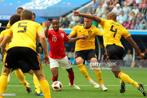 Raheem Sterling of England controls the ball under pressure of Belgium defense during the FIFA 2018 World Cup Russia Playoff for third place match...