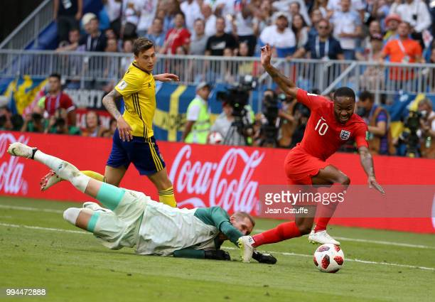 Raheem Sterling of England goalkeeper of Sweden Robin Olsen Victor Lindelof of Sweden during the 2018 FIFA World Cup Russia Quarter Final match...