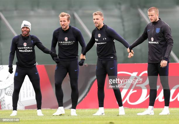 Raheem Sterling of England Harry Kane of England Jordan Henderson of England and Eric Dier of England holds hands while taking part in a drill during...