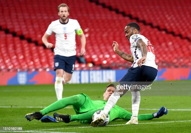 Raheem Sterling of England has a shot saved by Wojciech Szczesny of Poland during the FIFA World Cup 2022 Qatar qualifying match between England and...